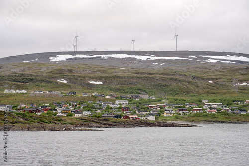 village and electric wind mills on Barents sea,  Batsfjord, Norway