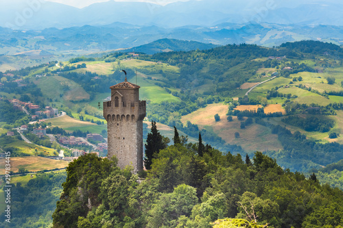 Tuinposter Oude gebouw Tower Montale or Terza Torre Montale or Third fortress tower on Monte Titano, Republic San Marino. Aerial top view of landscape valley and hills of suburban district