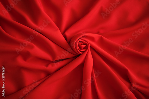 Red batiste made of cotton. sample of red soft fabric with pleats. Top view - 297836241