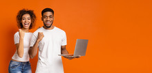 Happy Black Couple Enjoying Information On Laptop