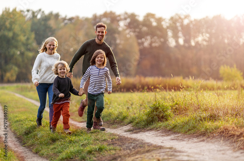Fotografiet Young family having fun outdoors