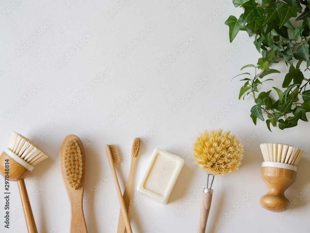 Fototapety, obrazy: Dish washing brushes, soap, bamboo toothbrushes and green houseplant. Sustainable lifestyle zero waste concept. Clean without waste. No plastic objects.