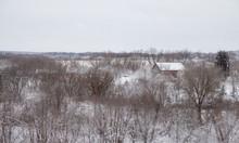 Barn Sitting Under A Overcast Sky On A Snowy Day