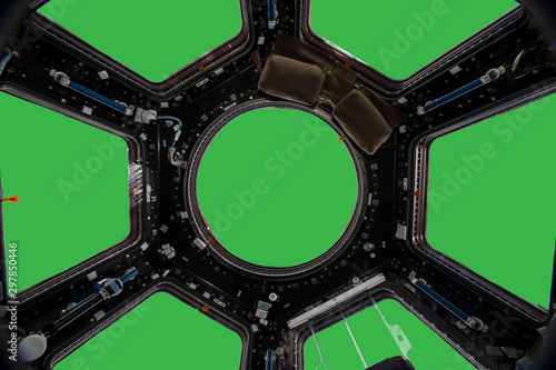 Porthole of space station isolated on green background. Elements of this image furnished by NASA. - 297850446