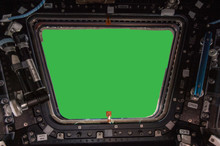 Porthole Of Space Station Isolated On Green Background. Elements Of This Image Furnished By NASA.