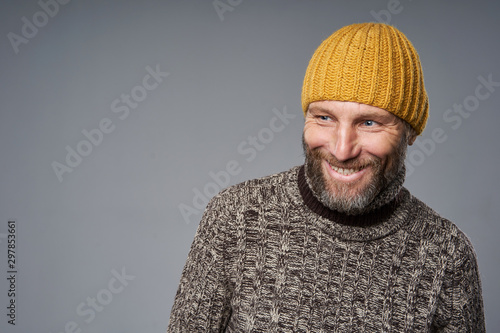 Canvastavla  Happy laughing mature man in warm sweater