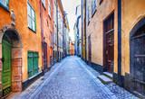 Fototapeta Uliczki - Charming colorfu narrow streets of old town in Stockholm, Sweeden