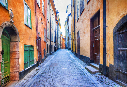 Charming colorfu narrow streets of old town in Stockholm, Sweeden Wallpaper Mural