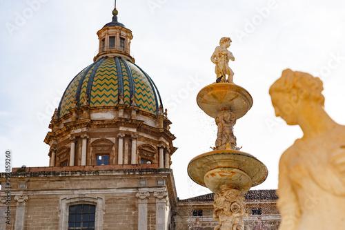 Photo figures of Praetorian fountain in Piazza Pretoria, San Giuseppe dei Teatini dome