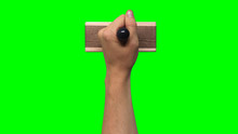 Hand Holding Large Stamp On Chroma Key Green Background