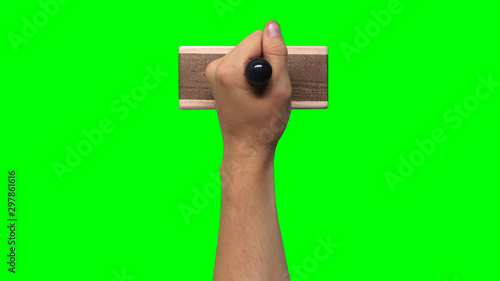 Hand Holding Large Stamp on Chroma Key Green Background Fototapet