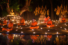 CHIANG MAI, THAILAND - May 18:  Visakha Puja Day Thai Monks Sitting Meditate With Many Candle At Phan Tao Temple  On May 18, 2019 In Chiang Mai, Thailand.