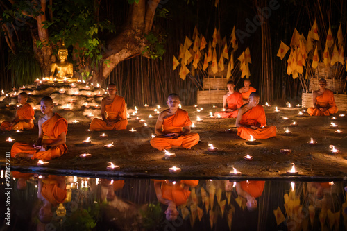 CHIANG MAI, THAILAND - May 18:  Visakha Puja Day Thai monks sitting meditate with many candle at Phan Tao temple  on May 18, 2019 in Chiang Mai, Thailand Fototapet