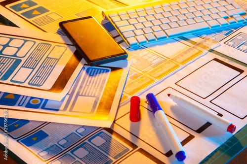 Layout interface app on the desktop. Smartphone designer. Application architecture. Markers on the desktop. Creating apps for education. Design digital projects. UX design. Office designer app.