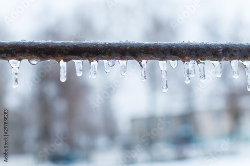 icicles on a metal crossbar