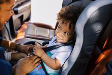 Smiling Baby Boy Looking At Hi...
