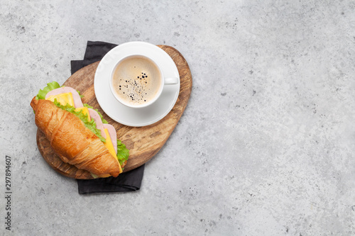 Fotografija Coffee and croissant sandwich