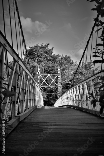 howley-suspension-footbridge-at-victoria-park-passing-over-the-river-mersey-this-bridge-is-around-100-years-old-and-is-hidden-gem-in-warrington-town-first-ever-taken-this-way-england