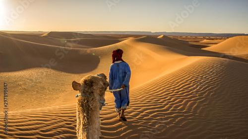 tourist in sahara morocco desert walking in dune landscape