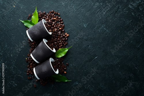 Canvas Prints Cafe Paper cups for coffee and coffee beans. On a black stone background. Top view. Free space for your text.