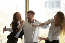 Male Colleague Set Apart Aggressive Business Women Fighting In Office