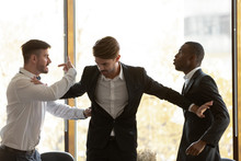 Male Colleague Set Apart Angry Diverse Businessmen Fighting In Office