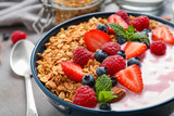 Tasty homemade granola with yogurt on grey table, closeup. Healthy breakfast