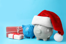 Piggy Banks With Santa Hat And...