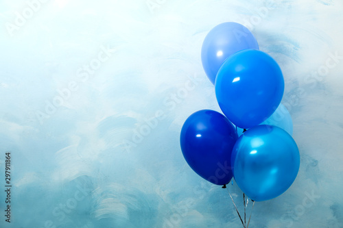 Bunch of balloons on light blue background, space for text Canvas-taulu