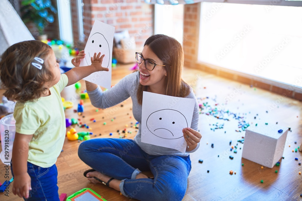 Fototapety, obrazy: Young beautiful psicologist and toddler doing therapy using emoji emotions at kindergarten