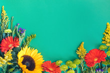 Different Colorful Summer Flowers Lying On Mint Background
