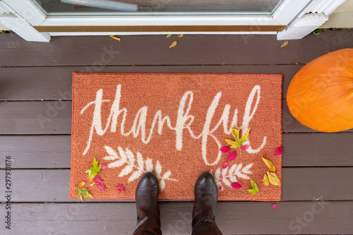 Fotografie, Obraz  Welcome mat with the word Thankful on front doorstep