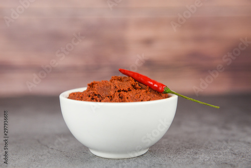 Canvas Prints Hot chili peppers curry paste and red chilli peppers background - ingredients table asian food spicy in thailand