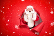 canvas print picture - Emotional Santa Claus on the red background.