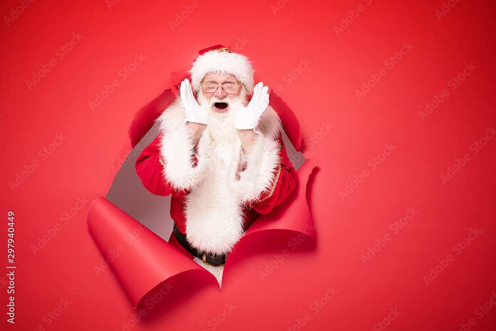 Fototapety, obrazy: Santa Claus on the red background.