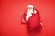 canvas print picture - Santa Claus with the big gift box.
