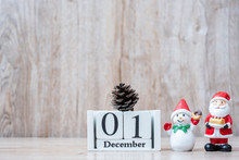 1 December Calendar With Christmas Decoration, Snowman, Santa Claus And Pine Tree  On Wooden Table Background, Preparation For Holiday, Happy New Year And Xmas Concept