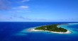 Kuramathi, tropical atoll island on Maldives, wide aerial view of overwater bungalows and palm trees, luxury vacation concept