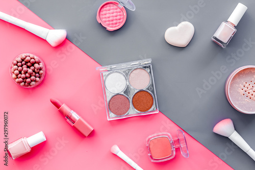 Fototapety, obrazy: Makeup background with rounge, powder and tools on pink and grey table top view