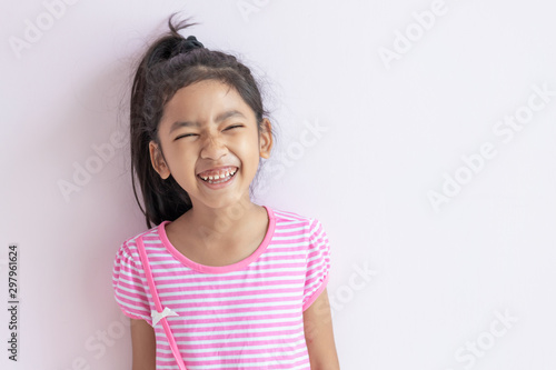 The child laughing and smiling with happiness. Fototapet