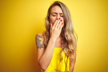 Young Attactive Woman Wearing T-shirt Standing Over Yellow Isolated Background Bored Yawning Tired Covering Mouth With Hand. Restless And Sleepiness.