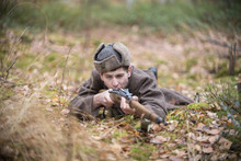 A Soldier Of World War II Is Lying In The Forest And Aiming