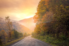 Autumn Mountain Scenery With Beautiful Light. Foggy Morning. Mountain Windy Road Among The Forest