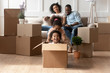 Excited little kids have fun playing on moving day