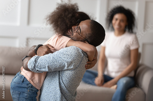 Foto op Canvas Wild West Happy little girl hug dad reunited after separation