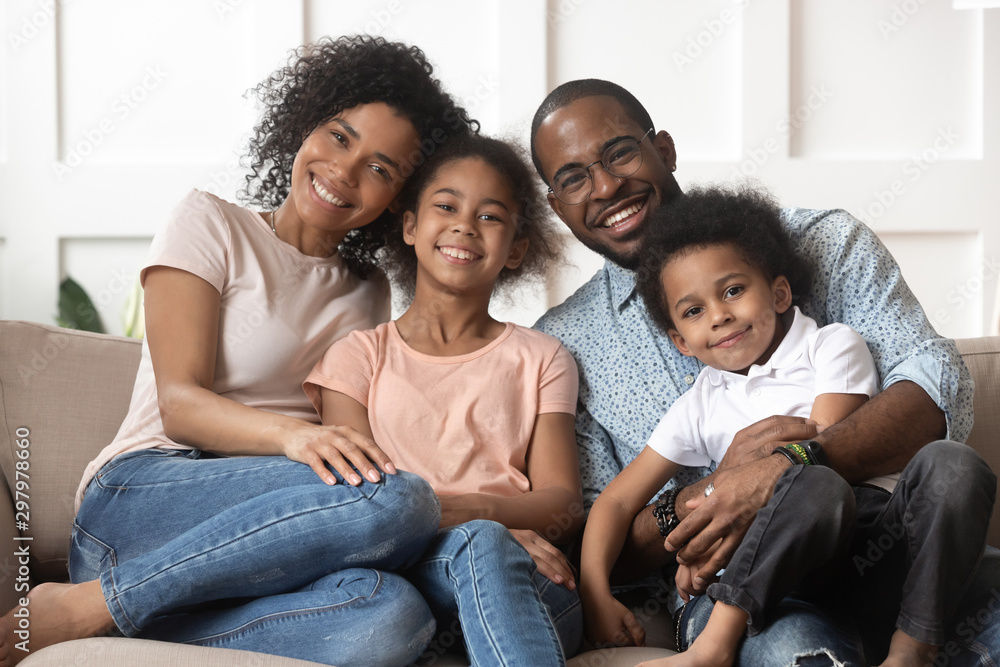 Fototapety, obrazy: Portrait of black family with kids relax on couch