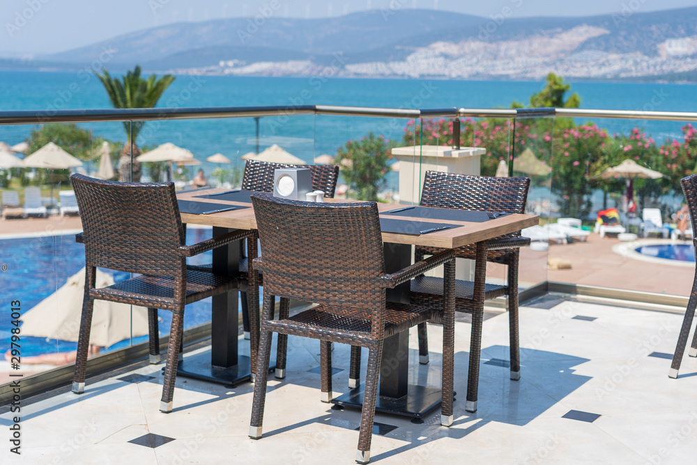 Fototapety, obrazy: Table and chairs in restaurant , Turkey. Beach cafe near sea, outdoors. Travel and vacation concept