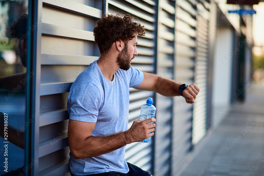 Fototapety, obrazy: Sportsman making pause during exercising in urban area.