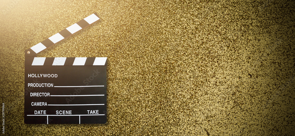 Movie clapper board on gold background