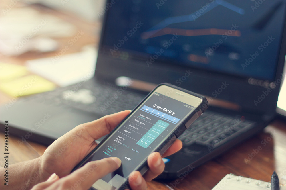 Fototapeta Businessman using mobile smartphone with data information banking network connection on screen, mobile banking and online payment.